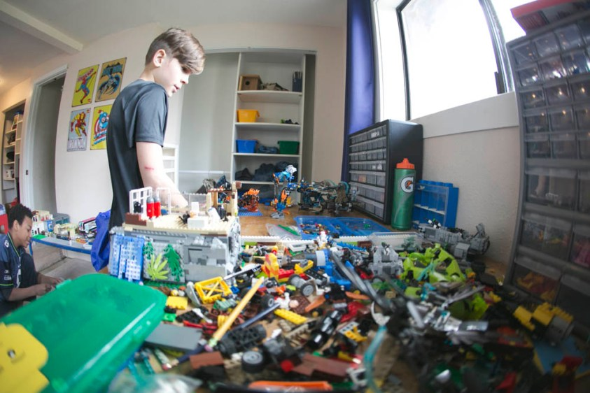 The boys love playing LEGO in their clean room.