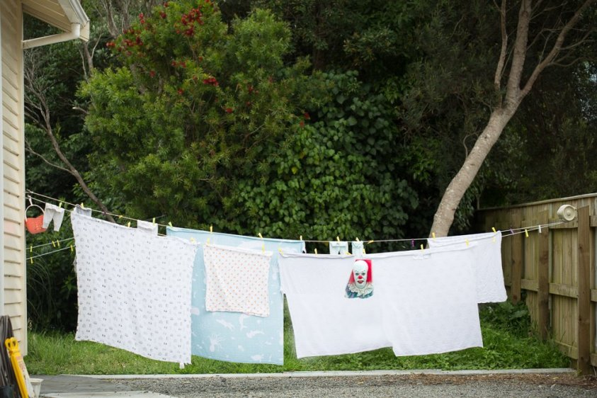 Watch out for clowns as you hanging clothing on the clothesline...