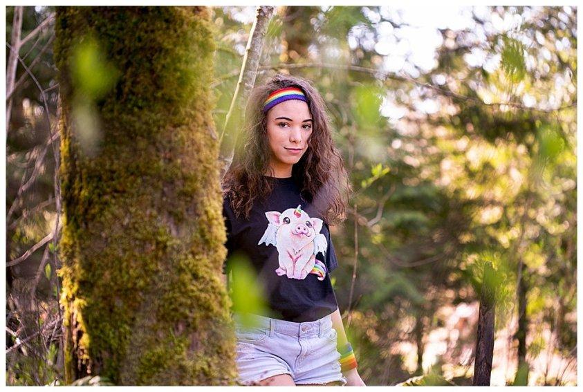 Dark rainbow girl in the woods.