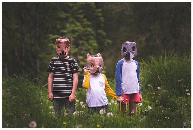 Three kids in animal masks heading in to the Pet Sematary.