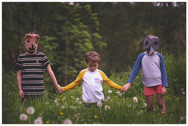 Three kids in animal masks heading to Pet Sematary.