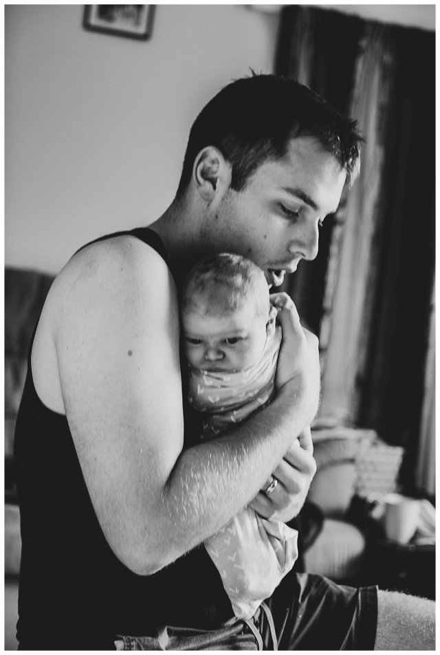 Jared holding newborn Abel