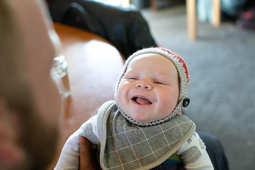 Abel smiling while wearing aviatrix knit hat.