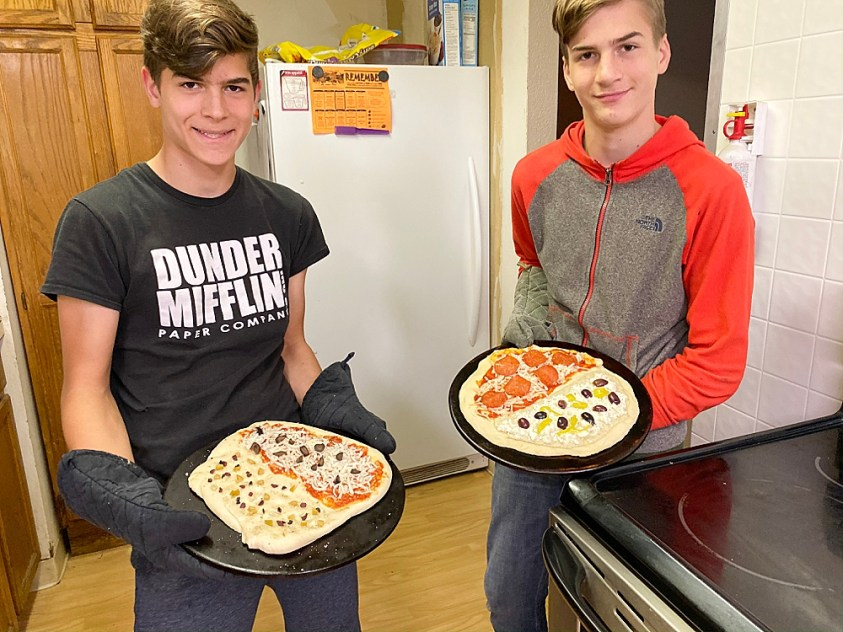 Hezekiah and Tucker make pizza for chemistry and history class. Homeschooling high school.