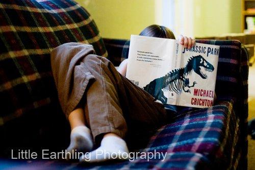 Enoch, age nine, reading Jurassic Park