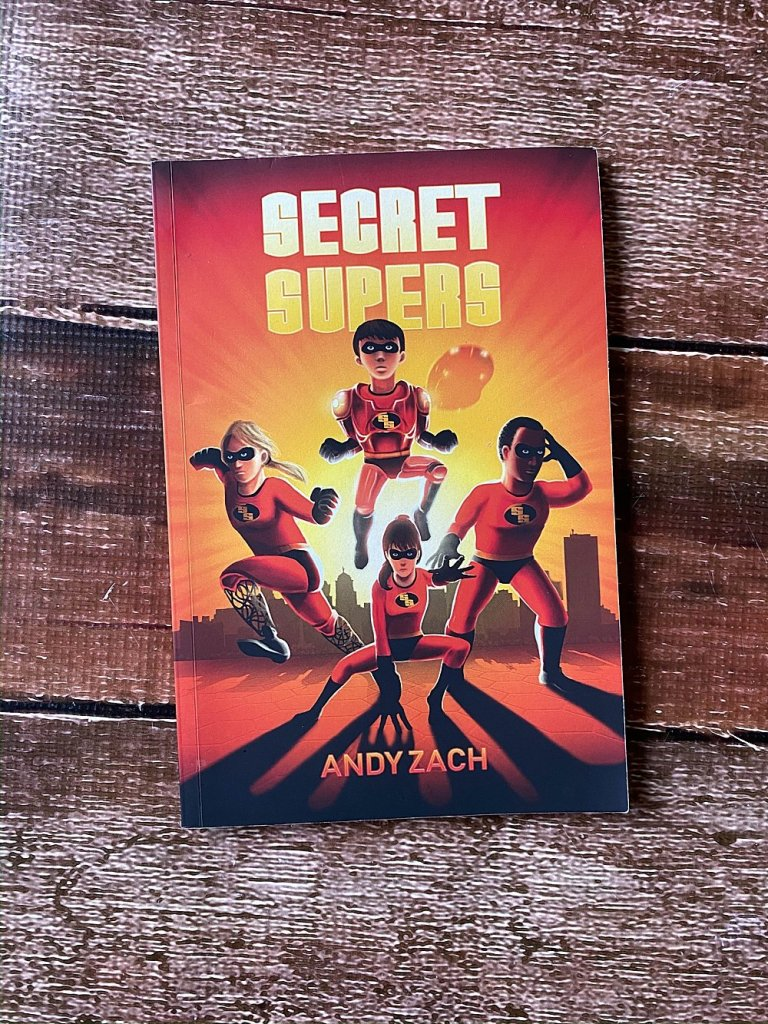 Secret Supers by Andy Zach. A book about special kids who suddenly have special families.