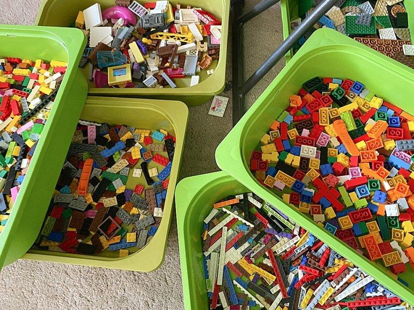 IKEA bins filled with LEGO bricks.