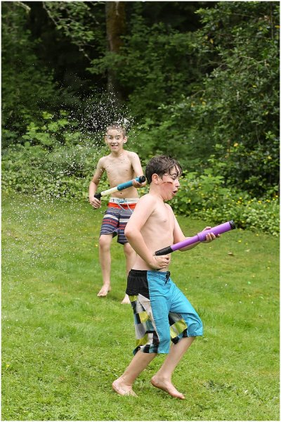 Apollo and Owen having a water fight.