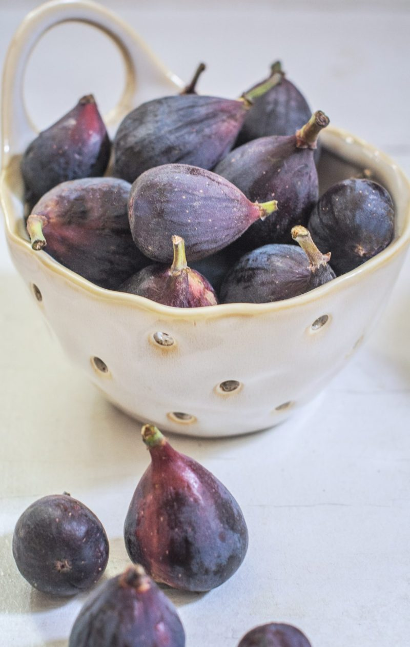 White bowl with fresh mission figs