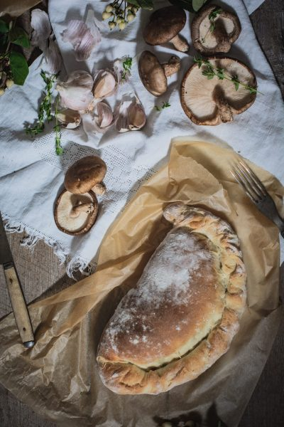 Whole wild mushroom, garlic and potato calzone recipe, baked and ready to serve.