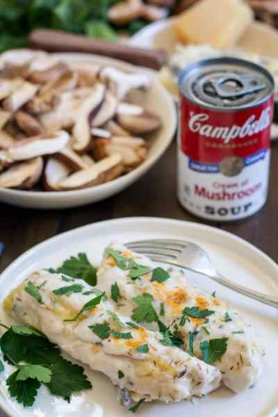 Mushroom Ricotta Manicotti on white plate with Campbells Condensed Soup in background