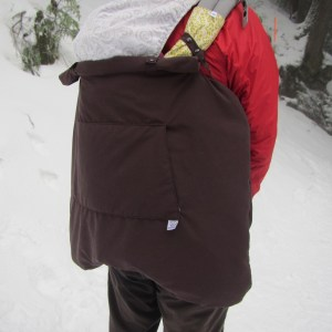 3-season baby carrier cover in back carry position with hood rolled