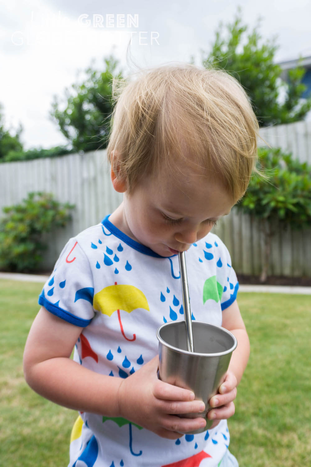 Child uses a U-Konserve straw and Klean Kanteen cup