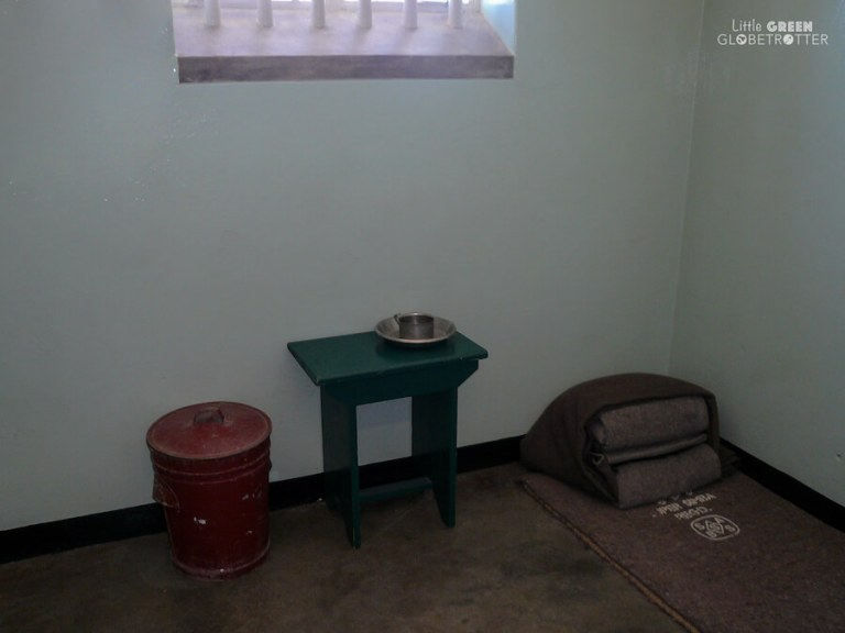 The inside of Nelson Mandela's cell on Robben Island. Racism in South Africa prevails.