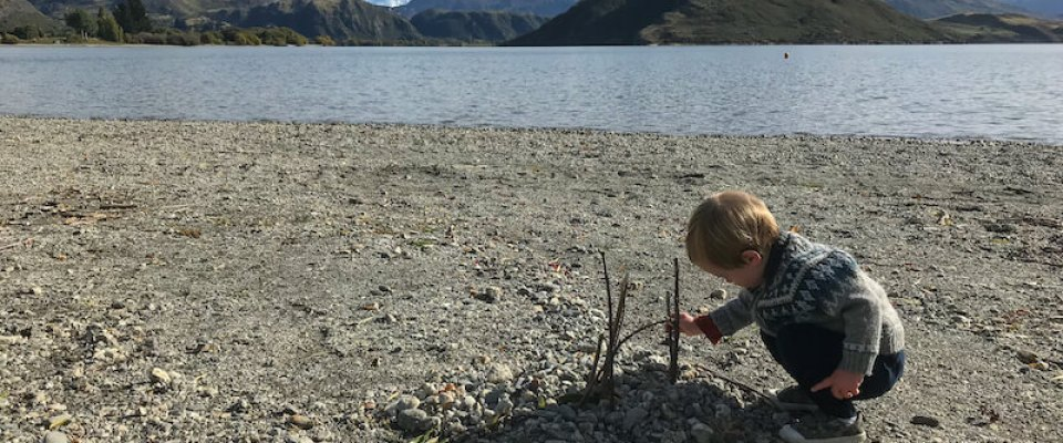 Homeschooling a 3 year old includes practical life skills and time outdoors, like building a campfire.