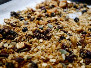 Photo of toasted granola on a tray for Little Green Ways blog