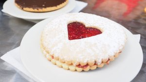 Photo of a vanilla-and-strawberry biscuit and a chocolate biscuit, on white plates, for Little Green Ways blog