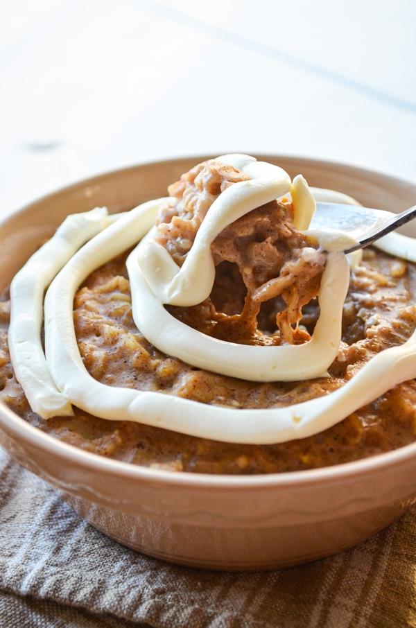 A spoon lifts a big spoonful of cinnamon roll oatmeal.