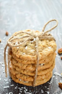 6 cookies stacked and wrapped in twine. Coconut and pecans sprinkled around.