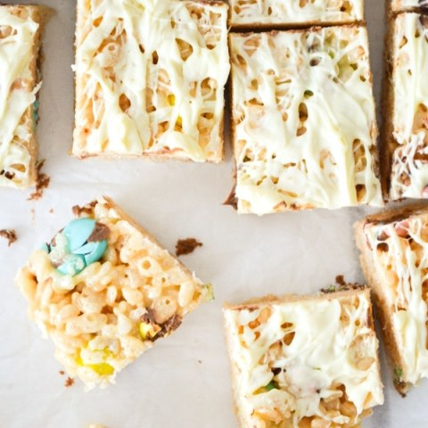 A top view of easter rice krispie squares, drizzled with white chocolate.