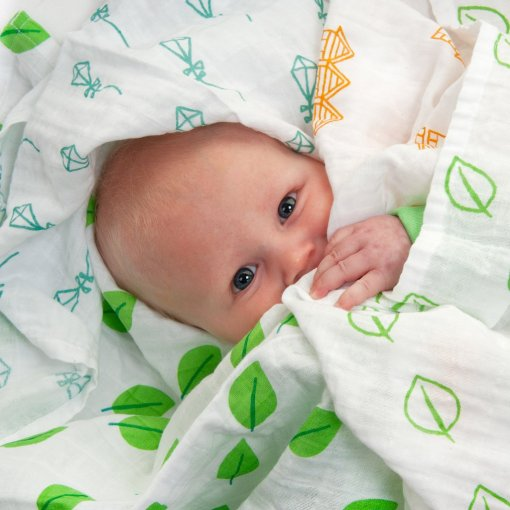 Baby in LittleLeaf 100% Organic Cotton Baby Muslins