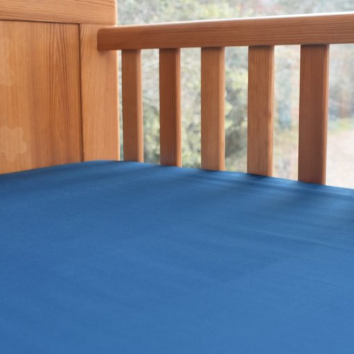 Fitted Organic Cotton Cot Bed Sheet in an Ocean Blue Colour, Ethical Bedding for Baby