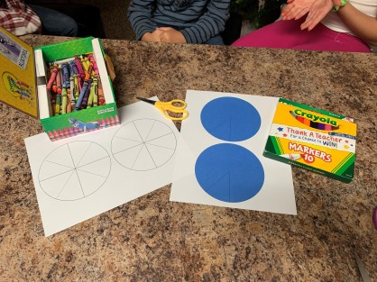 Supplies needed for Pinwheels language activity include scissors, markers, and crayons.