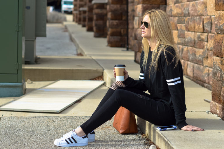 girl wearing adidas superstar