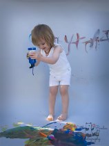 Birthday photography Kent paint splash boy squirting paint