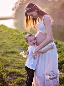 Maternity photography in Hythe Kent by cuddling bump