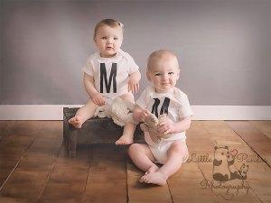 Boy girl twins with teddy