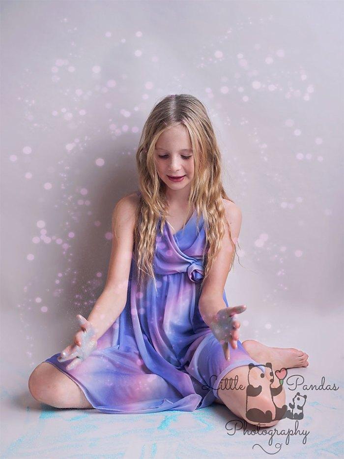 Girl with glitter around her