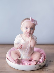 Little baby girl with pearls