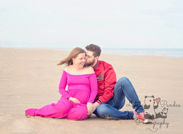 Pregnant lady husband on beach couple