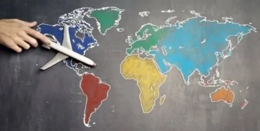 Airplane over map of continents