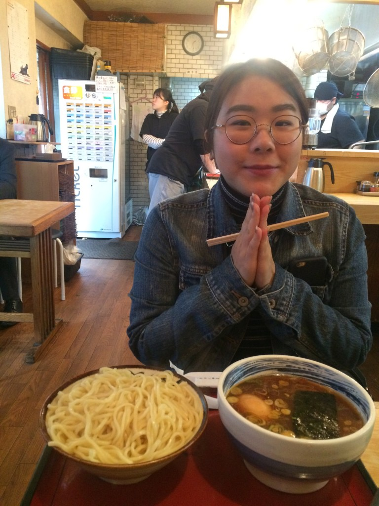 Alisa praying to the tsukemen gods to allow her stomach to contain this massive portion of noodles.