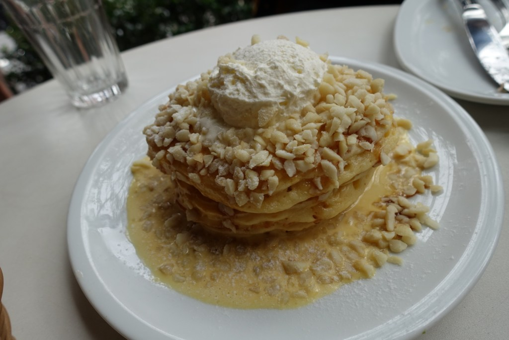 Sinful pancakes with an incredibly generous serving of nuts and cream!