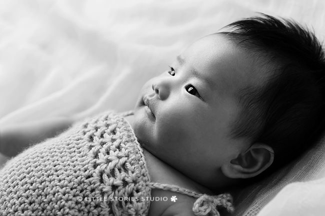 backlit black and white baby photos