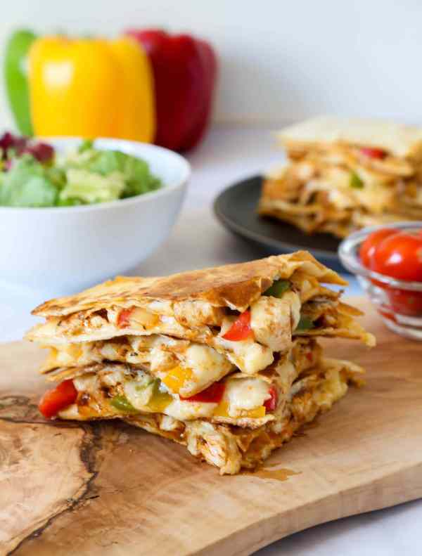 Easy and quick cheesy and flavourful chicken fajita quesadillas, with a generous amount of grated cheese without all the extra calories.