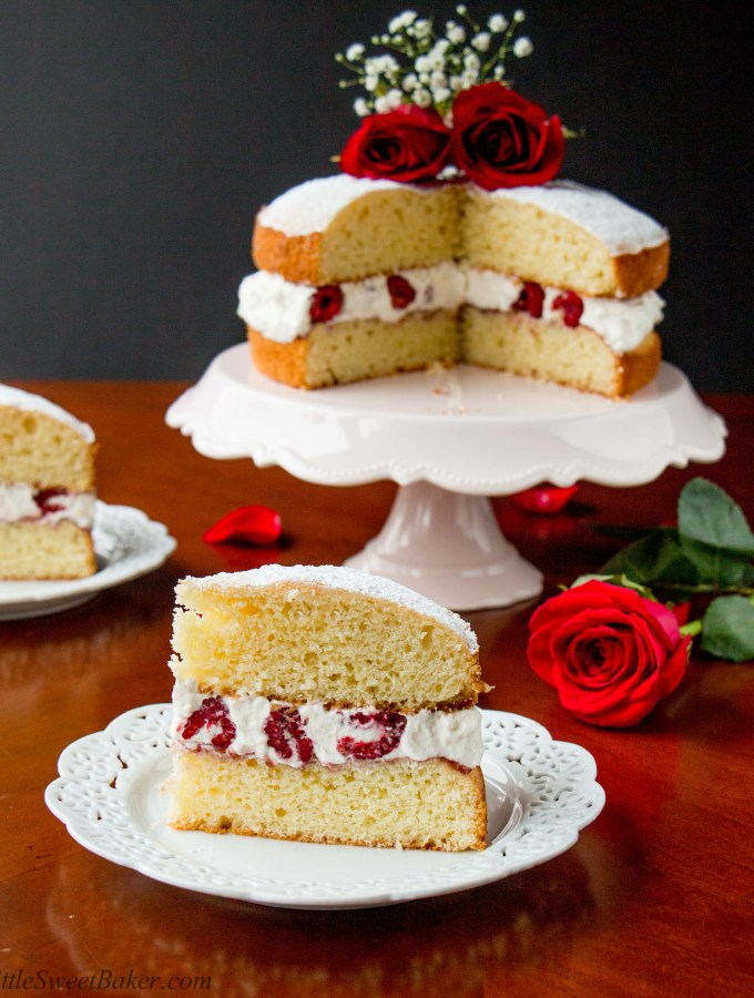 A buttery and tender British style sponge cake layered with raspberry jam and whipped cream in between. This version is dazzled up with the addition of fresh raspberries in the filling.
