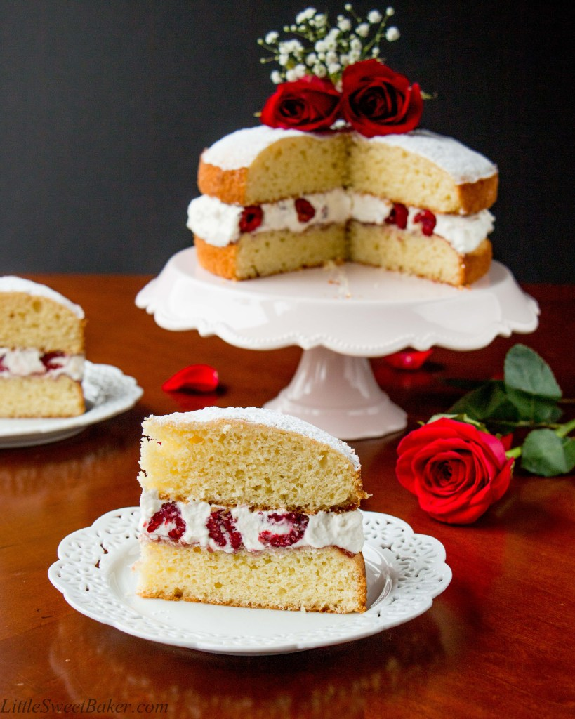 A buttery and tender British style sponge cake layered with raspberry jam and whipped cream in between. This version is jazzed up with the addition of fresh raspberries in the filling.