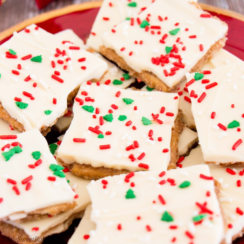 Light and crispy saltine crackers surrounded by a buttery toffee and topped with creamy white chocolate makes this little treat absolutely addictive! You won't be able to just have one. #whitechocolate #christmascrack #crackcandy #christmastoffee #saltinetoffee #saltinecrackertoffee