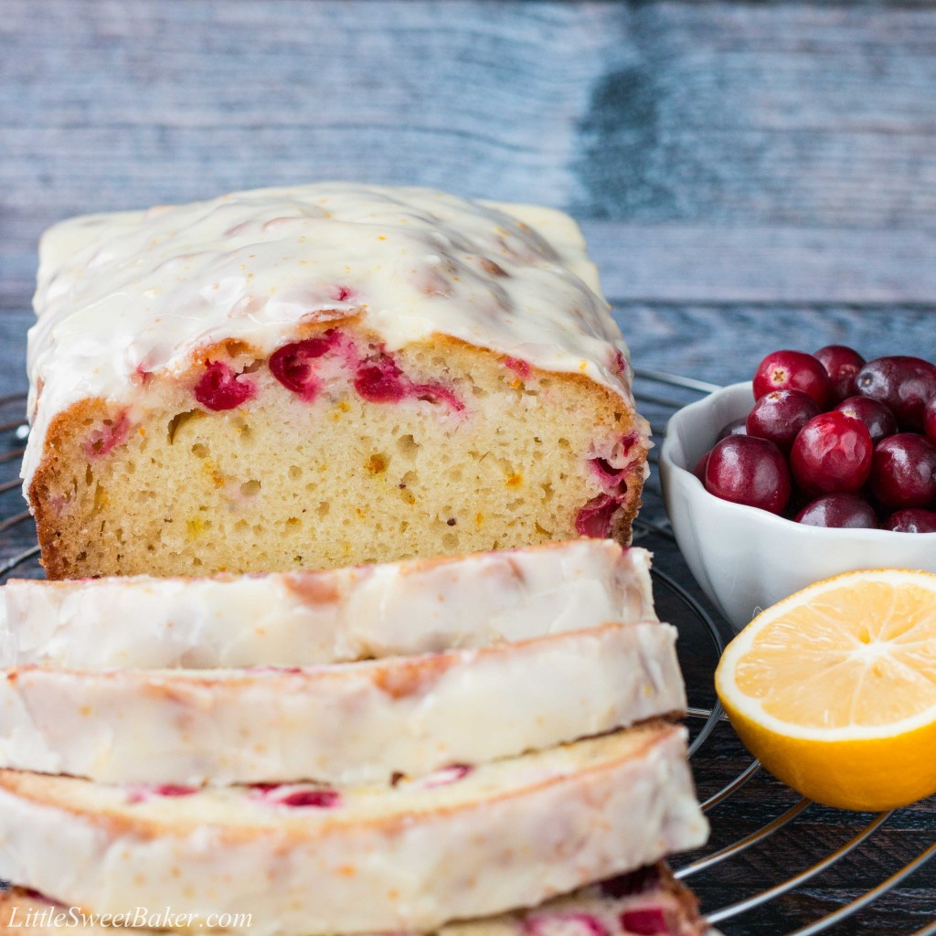 A soft and moist citrus flavored bread dotted with bright tart cranberries and topped with a sweet vibrant glaze! #cranberrybread #cranberryorangebread #orangebread #cranberrysweetbread