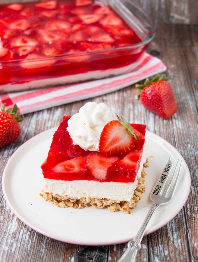 Crunchy, creamy, sweet and salty all come together in this fabulous strawberry pretzel salad. Don't let the name fool you, this recipe is 100% a dessert! #strawberrypretzelsalad #strawberrypretzeldessert
