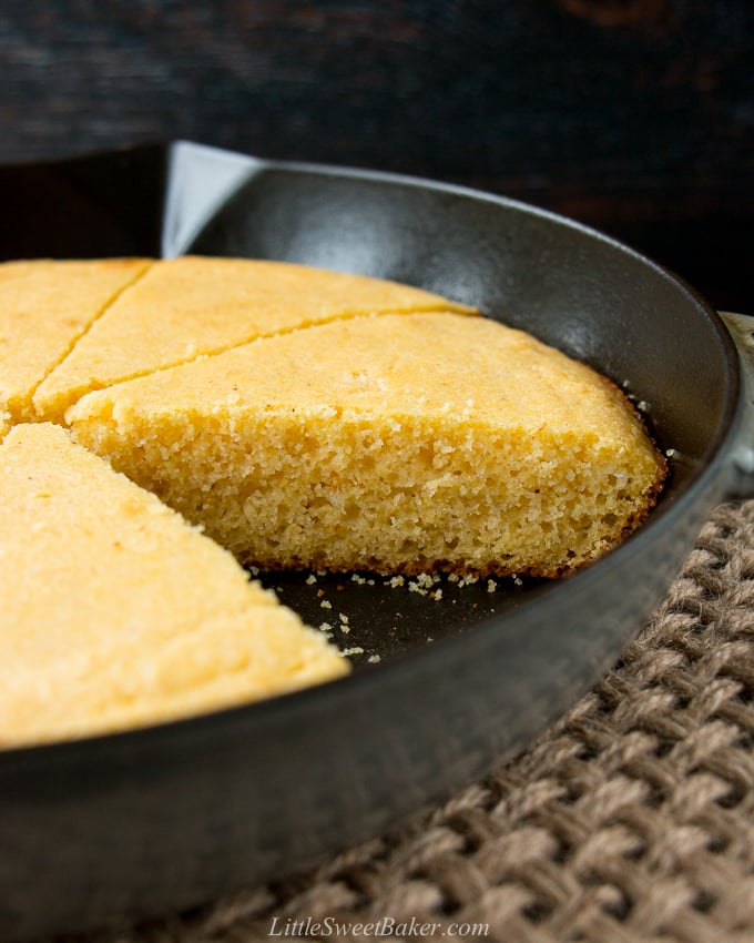 This one-bowl recipe for tender and buttery cornbread is baked in a cast iron skillet for a delightfully crispy crust. #cornbreadrecipe #skilletcornbread #buttermilkcornbread #castironcornbread