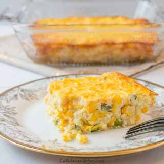 This custard-style corn casserole is sweet and creamy. It's made from scratch with no cornbread mix. #corncasserole #Thanksgiving #sidedish #recipe