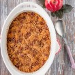 This wonderful casserole side dish is both sweet and savory. It's filled with tender chunks of apples and butternut squash, and it's topped with a buttery and crunchy pecan crumble. #holidaysidedish #butternutsquashcasserole #Thanksgivingsidedish #Christmassidedish