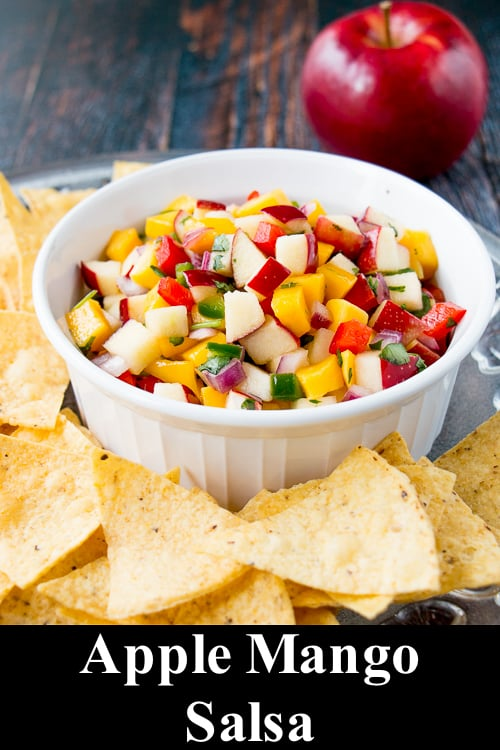 Get the party started with this fresh, tangy, and sweet apple mango salsa. It's amazing served with tortilla chips or even grilled fish or chicken. #applesalsa #mangosalsa #freshfruitsalsa #appetizer #fiesta #sponsored #onappleaday @ontarioapples