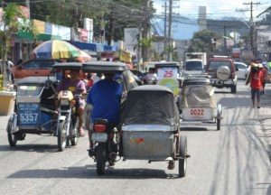 Travel by Tricycle Trikes in Manila, Philippines, Southeast Asia