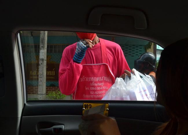 Vendor of Deep Fried Bananas Kuay Tod in Bangkok Traffic, Southeast Asia